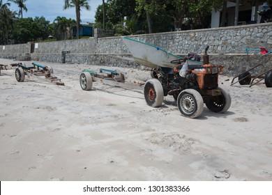 Small Tracktor carry a boat in the beach nera Hua Hi Thailand