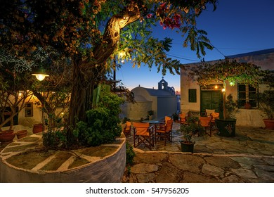 Small traditional paved square at dusk, in Chora Amorgos Greece