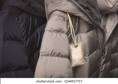 Small transparent plastic bag with winter jacket's filling (down) sample. Choosing qualitative filling for winter clothes.