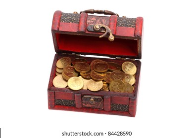 Small treasure chest of gold coins isolated on a white background