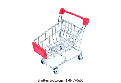 Small trolley on a white background. Shopping concept.