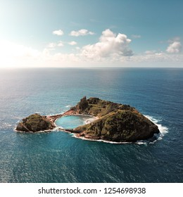 Small tropical island from above / drone shot, ocean around, laguna inside, paradise, Azores islands, Portugal