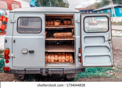 A small truck brought hot bread to the store.