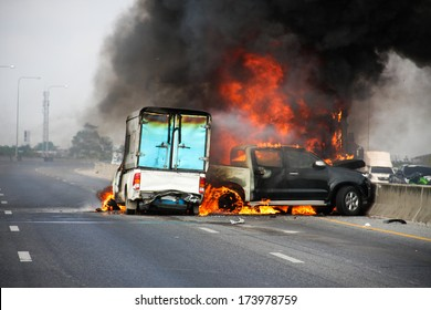 small truck with Truck caps car explosive car crash and catch fire on motorway