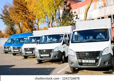 Small trucks, vans, courier minibuses stand in a row ready for delivery of goods on the terms of DAP, DDP according to the delivery terms of Incoterms 2010. Belarus, Minsk, August 13, 2018.
