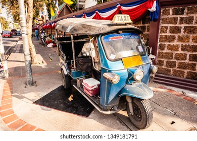 A small Tuk-tuk taxi. This kind of vehicles are used in Thailand as a cheap transport service for tourists and locals