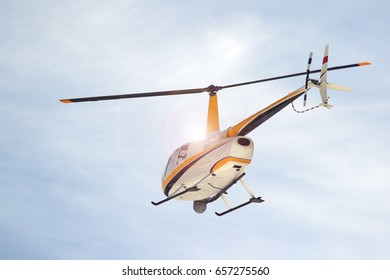 Small turbine helicopter in flight with camera and forward looking infrared (FLIR) camera equipment