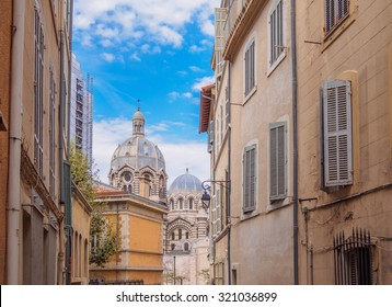 Small typical street in Marseille with view of Cathedral, France