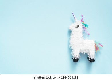 Small unicorn pinata for kids birthday party.