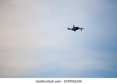 Small unregistered consumer quadcopterdrone flying. These kind of small drones don't need license to be operated, as they are light and meant for beginners, amateurs and enthusiasts.