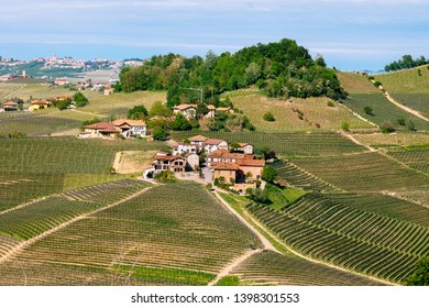 Small village among Langhe  vineyards. Springtime scene.  Viticulture in Barolo, Piedmont, Italy, Unesco heritage. Barolo, Nebbiolo, Dolcetto, Barbaresco red wine.