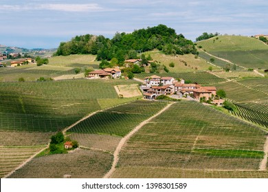 Small village among Langhe  vineyards. Springtime scene.  Viticulture in Barolo, Piedmont, Italy, Unesco heritage. Barolo, Nebbiolo, Dolcetto, Barcaresco red wine.