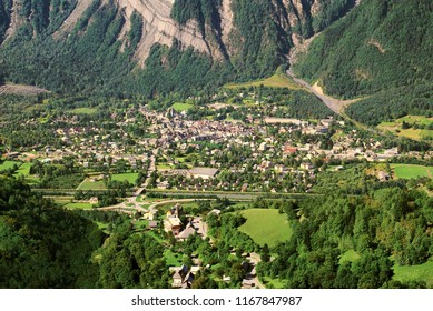 The small village of Bourg d'Oisans in the hollow of its valley of the French Alps.