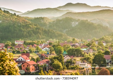 A small village and buildings in the green Balkan mountains of Montenegro.
