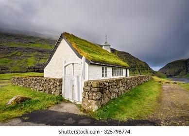 Small village church in Saksun located on the island of Streymoy, Faroe Islands, Denmark