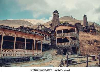 Small village Dartlo with traditional stone buildings and defensive towers in Tusheti. Adventure holiday. Travel to Georgia. Green ecology tourism. Eco trekking tour. Balcony decorated with fretwork