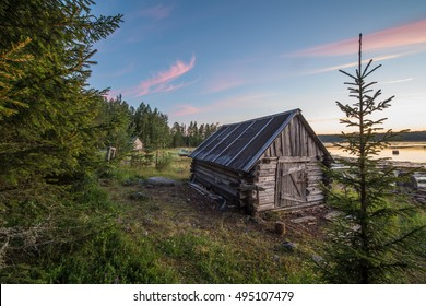 Small village house near of the White Sea during the sunset