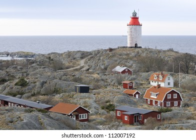 A small village with a lighthouse in the archipelago