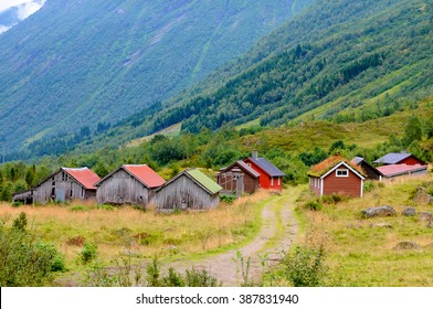 A small village with its little houses in the middle of the Norwegian nature.