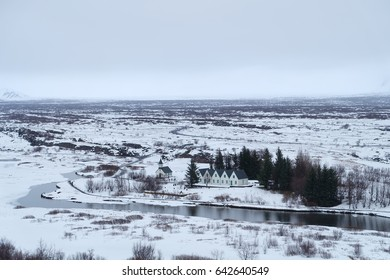 small village near the river in winter. the land covered with snow,Iceland