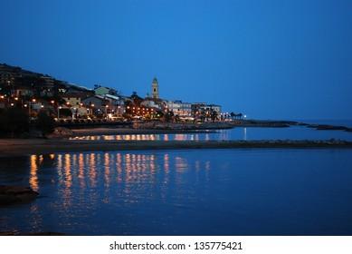 Small village on Mediterranean sea at dusk, Santo Stefano al Mare, Liguria, Italy