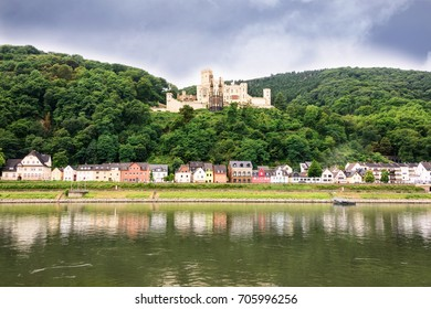 Small village on the Rhine River near Koblenz, Germany with the Stolzenfels Palace in the background.