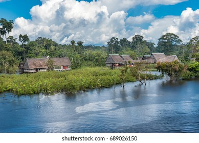 Small village on the Rio Yarapa Amazon river during afternoon rain shower