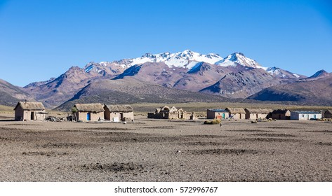 Small village of shepherds of llamas in the Andean mountains. High Andean tundra landscape in the mountains of the Andes. The weather Andean Highlands Puna grassland ecoregion