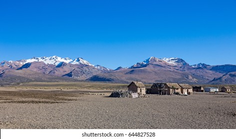 Small village of shepherds of llamas in the Andean mountains. High Andean tundra Landscape in the mountains of the Andes. The weather Andean Highlands Puna grassland ecoregion. Sajama National Park.