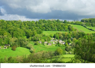 The small village of Slad nesling in the beautiful Slad Valley in spring, The Cotswolds, Gloucestershire, England, UK
