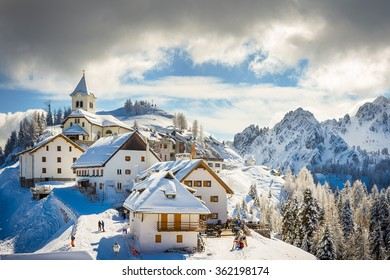 A small village snow covered on the peak of Mt. Lussari on a sunny winter day, Tarvisio, Italy