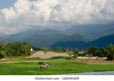 Small villege in green field the hill Nan province, Thailand