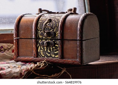 Small vintage key and old treasure chest
