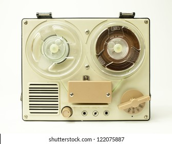 a small vintage reel to reel tape recorder