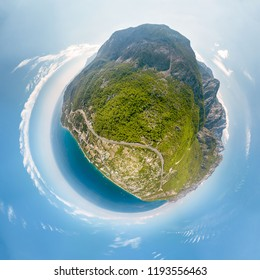 Small volumetric planet with protruding mountains, the sea and the stratosphere around. Spherical Panorama 360 degrees sea and mountains near Kemer, Turkey. Aerial view
