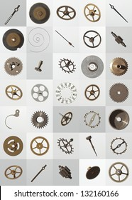 small watch cogs and other parts, looking down from above background