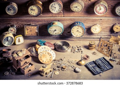 Small watchmaker's workshop with clocks to repair