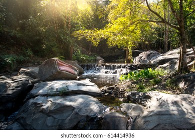 small water fall in the wild and sunlight.