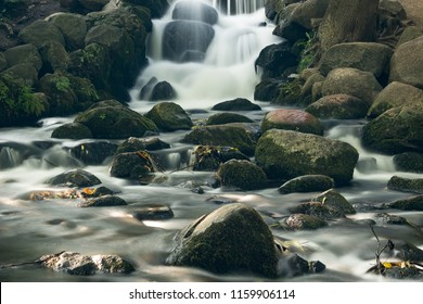 Small water stream flowing in a city park, slow photographd with ND filter.