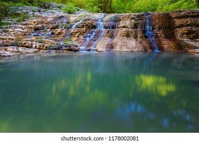 Small waterfall in mountain of Caucasus. The beautiful summer landscape in with water and water stream on forest of Caucasus mountain.