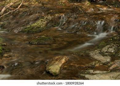 Small waterfall near Kouty nad Desnou village in summer day in forest - Shutterstock ID 1800928264
