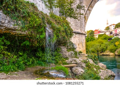 A small waterfall on the banks of the Neretva River under the Old Bridge in Mostar, Bosnia and Herzegovina