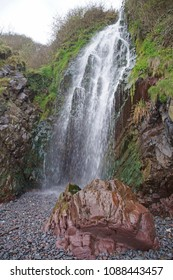 Small waterfall on the beach close to the small fishing village Clovelly in the northern part of Devon, England