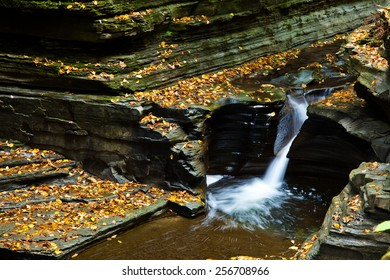 Small waterfall and pool in autumn