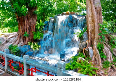 Small Waterfall set between to ficus trees Manila Philippines