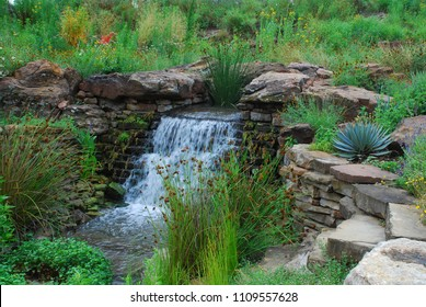 Small waterfall surrounded by Texas native plants