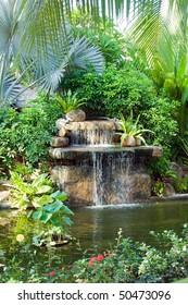 small waterfall in tropical garden