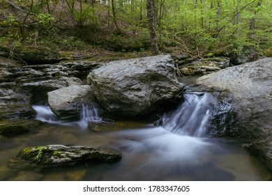 Small waterfall tucked back in the woods