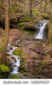 Small waterfall in the woods on a gray, rainy day