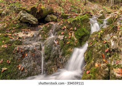 Small waterfall of Zejmarska roklina, Narodny park Slovensky Raj (National park Slovak paradise), Slovakia, Eastern Europe - Shutterstock ID 334559111